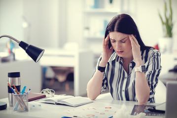 Sad depressed woman having a headache