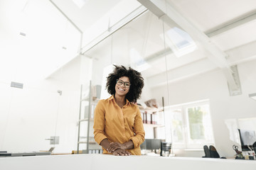 Portrait of young woman with glasses in office