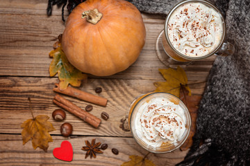 Fresh pumpkin latte, smoothie on wooden rustic background, top view