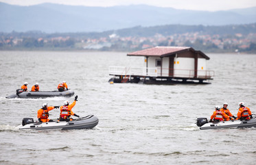 Participants from NATO and partner countries practice disaster response during NATO's Euro-Atlantic Disaster Response Coordination Centre (EADRCC) field exercise on the Modrac Lake near Tuzla
