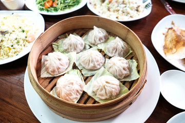 Xiaolongbao with cabbage on basket