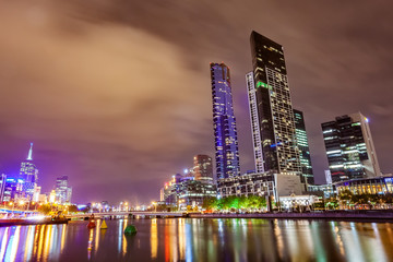 A view across the Yarra river at the landmark of Melbourne downtown during the city's nightime..