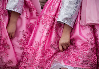 Nowruz (Iranian New Year) celebration in Paris (France). Girls dancing in traditional costumes. Closeup.