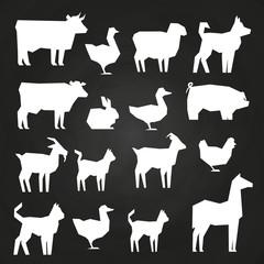 White farm animals silhouetes icons on black background