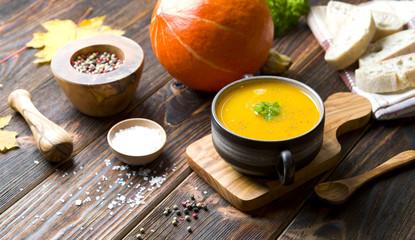 Pumpkin soup on wood