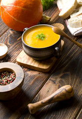 Pumpkin soup on wood