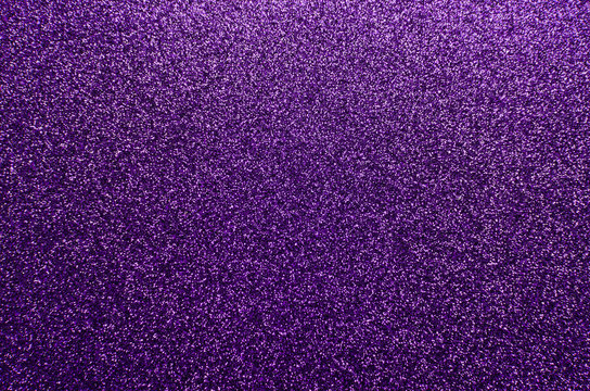 Sparkling and glittering purple background with a festive or party feel