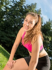 Portrait of young fit woman outdoors