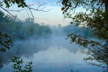 Morning Fog on the autumn river. Early autumn landscape