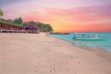 Traditional boat on Gili Meno beach in Indonesia, Asia at sunset