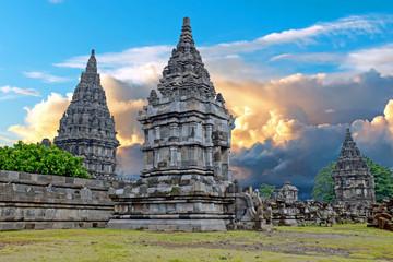 Papiers peints Edifice religieux Prambanan or Candi Rara Jonggrang is a Hindu temple compound in Java, Indonesia, dedicated to the Trimurti: the Creator (Brahma), the Preserver (Vishnu) and the Destroyer (Shiva) at sunset