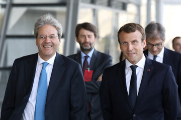 French President Emmanuel Macron and Italian Prime Minister Paolo Gentiloni arrive at the Confluences Museum as part of the 34th Franco-Italian summit in Lyon