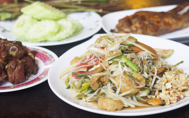 papaya salad.Fried pork.Grilled chicken and fresh vegetable Put on the table, use as a background