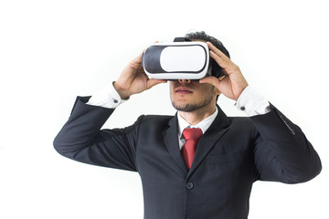 Businessman with glasses of virtual reality. Young guy in VR headset is looking at interactive screen. Playing mobile game app on device.