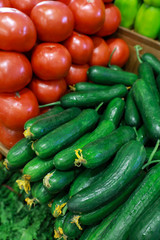 Fresh cucumbers and tomatoes in the greek grocery shop.