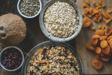 Homemade granola with dried apricots, cranberries, coconut, sunflower seeds, and oatmeal