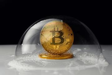 bitcoin. bitcoin in a soap bubble on black background