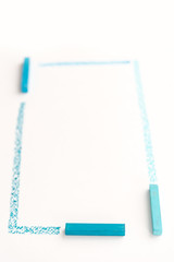 Close up photo of drawing lines by blue pastel chalks