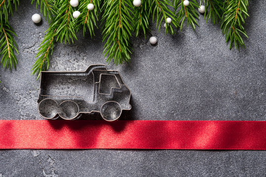 Christmas concepr, metal truck on grey background, copy space