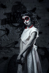 Little santa muerte girl with black curly hair