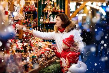 Family shopping Christmas presents at xmas fair
