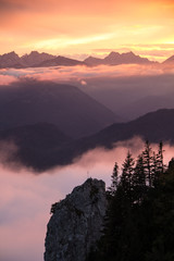 The sun setting at the Tegernseer refuge in Bavaria, Germany