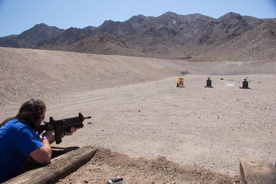 Firing an AR-15 assault rifle with grenade launcher on a shooting range in the desert of Nevada, USA