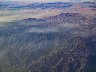Aerial view of San Bernardino Mountains and Lake Arrowhead, view from window seat in an airplane