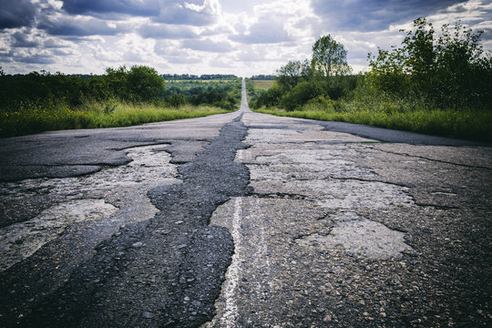 Bad road with damaged and broken asphalt, Difficult life concept