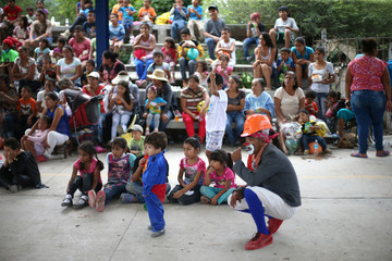 Children attend a show animated by clowns after an earthquake in La Nopalera