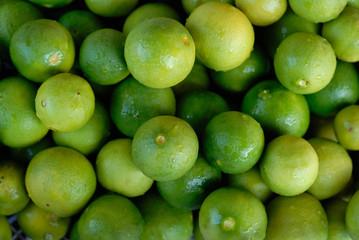 Green lemon stack closeup for background