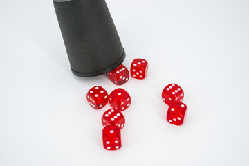 red dices and a cup