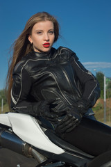 Sexy biker girl in a leather jacket