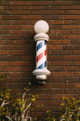 barber pole on a brick wall