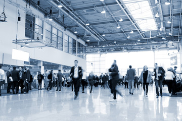 blurred visitors at a trade fair