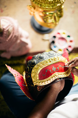Hands painting 'Hua Khon' traditional mask for Thai performing arts