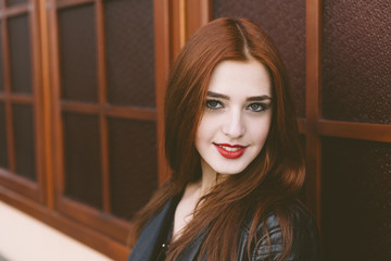 portrait of  happy girl with red hair