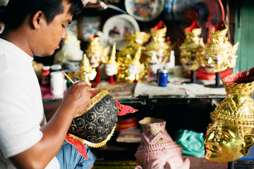 Local artist working on 'Hua Khon' traditional mask for Thai performing arts