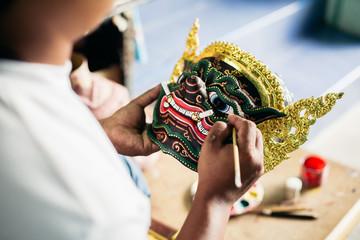 Artisan painting 'Hua Khon' traditional mask for Thai performing arts