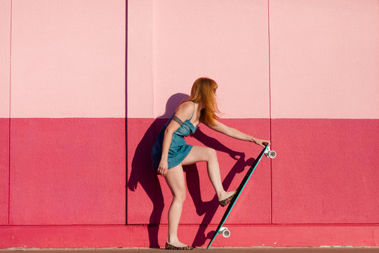 Young woman with a longboard