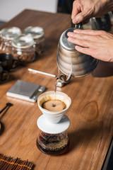Man preparing Steaming Filter Coffee