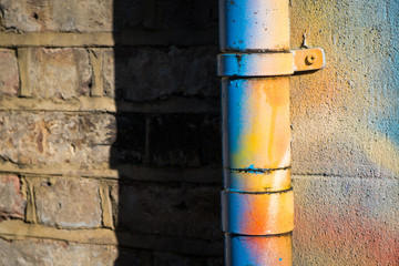 Drainpipe covered in bright spraypaint