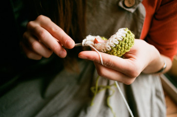 Close up shot of woman's hands knitting with a crochet