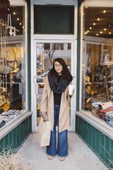 Stylish woman shopping at urban boutique