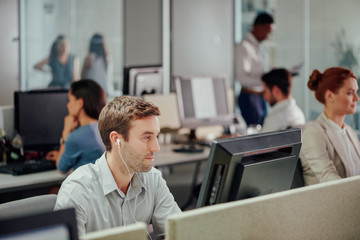 Businessman is dedicated employee working at computer in modern office