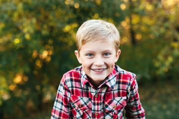 autumn portrait of a happy boy