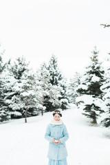 Little girl wearing a star wreath in a wintery scene