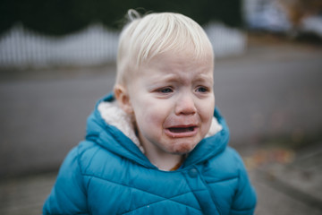 Portrait of a Toddler Boy Crying in his Winter Coat