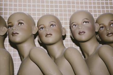 Row of mannequin children