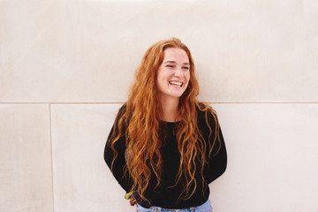 Smiling young red-haired woman